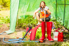Female farmer and gardening tools in garden Royalty Free Stock Image