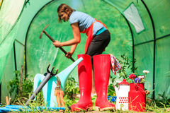 Female farmer and gardening tools in garden Stock Photos