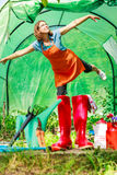 Female farmer and gardening tools in garden Stock Images