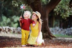 Female farmer and her little helper working in olive grove in Italy Stock Image