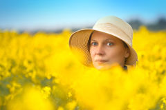 Female Farmer in Oilseed Rapeseed Cultivated Agricultural Field Royalty Free Stock Photo