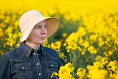 Female Farmer in Oilseed Rapeseed Cultivated Agricultural Field Royalty Free Stock Photos