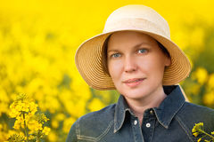 Female Farmer in Oilseed Rapeseed Cultivated Agricultural Field Stock Photography