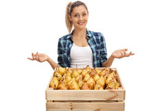 Female farmer posing with crate and gesturing with hands stock photos