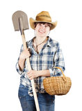 Female farmer   with spade and basket Royalty Free Stock Photo