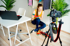 Female fashion blogger. Fashion and beauty blogger making video about shoes Stock Photography