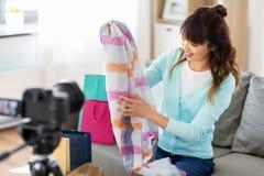 Female fashion blogger making blog about shopping stock images