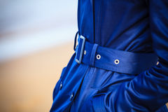 Female fashion. Closeup blue coat wit belt Royalty Free Stock Photos