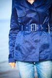 Female fashion. Closeup blue coat wit belt Stock Images
