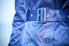 Female fashion. Closeup blue coat wit belt Stock Image