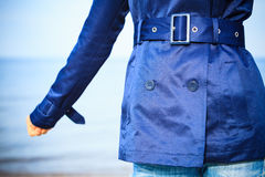 Female fashion. Closeup blue coat wit belt Stock Photos