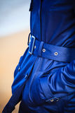 Female fashion. Closeup blue coat wit belt Royalty Free Stock Images
