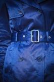 Female fashion. Closeup blue coat wit belt Stock Photos
