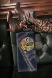 Female fashion closeup of woman legs on handbag Stock Images