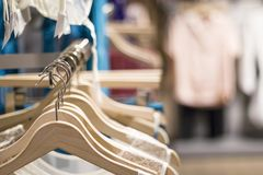 Women`s clothing store. Clothes on hangers close-up royalty free stock photo