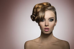 Female with fashion creative hairdo Royalty Free Stock Photos