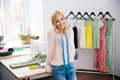 Female fashion deisgner standing in workshop Royalty Free Stock Images