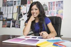 Female Fashion Designer At Desk Stock Photos