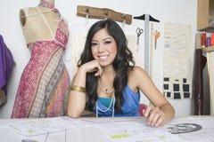 Female Fashion Designer At Desk Royalty Free Stock Image