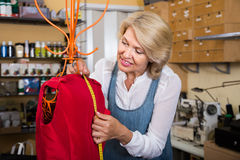 Female fashion designer hemming new clothes on mannequin Royalty Free Stock Photo