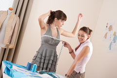 Female fashion designer measuring model Royalty Free Stock Photos