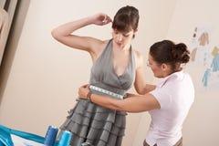 Female fashion designer measuring model Royalty Free Stock Images