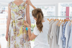 Female fashion designer measuring model Stock Photography