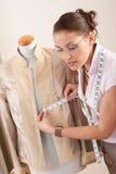 Female fashion designer taking measurement Royalty Free Stock Images