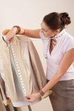Female fashion designer taking measurement Royalty Free Stock Photo