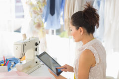 Female fashion designer using digital tablet Stock Photography
