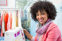 Female fashion designer using sewing machine Stock Image