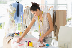 Female fashion designer working on fabrics Royalty Free Stock Image