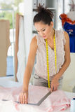 Female fashion designer working on fabrics Royalty Free Stock Photo