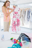 Female fashion designer working on floral dress at studio Stock Photo