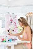 Female fashion designer working on her designs Royalty Free Stock Images
