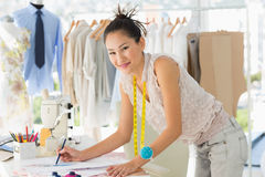 Female fashion designer working on her designs Stock Images