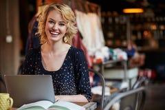 Female Fashion Designer Working At Laptop In Studio Royalty Free Stock Photos