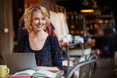 Female Fashion Designer Working At Laptop In Studio Royalty Free Stock Photography
