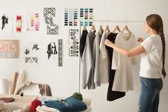 Female Fashion Designer Working On New Womenswear Collection In Stock Image