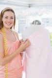 Female fashion designer working on pink fabric Stock Photos