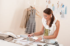 Female fashion designer working with sketches Stock Image