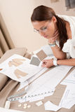 Female fashion designer working with sketches Royalty Free Stock Photography