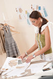 Female fashion designer working with sketches Stock Photography