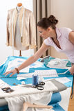Female fashion designer working at studio royalty free stock image