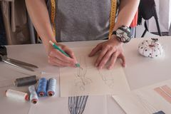 Female fashion designers drawing sketches for clothes in atelier Royalty Free Stock Images