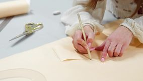 Female fashion designers drawing sketches for clothes in atelier. Sequence.  stock video footage