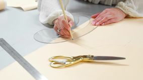 Female fashion designers drawing sketches for clothes in atelier. Sequence.  stock footage