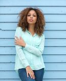 Female fashion model with curly hair standing outdoors Royalty Free Stock Images