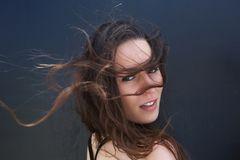 Female fashion model with hair blowing Royalty Free Stock Photography