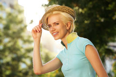 Female fashion model smiling with hat Stock Photo